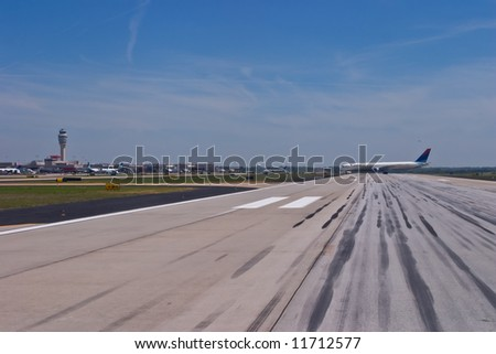 Delta aircraft exiting the runway at Hartsfield-Jackson Atlanta International Airport - stock photo