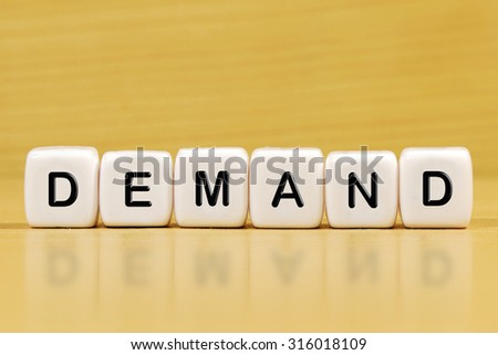 DEMAND word on blocks - stock photo