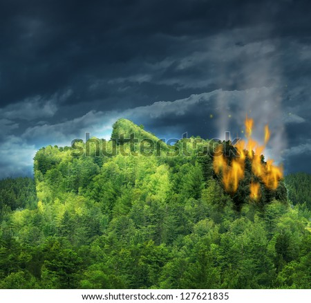 Dementia and losing memory and Alzheimer's disease with the medical icon of a forest mountain of trees in the shape of a human head and brain burning in flames as a loss in damaged mind function. - stock photo