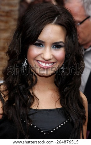 Demi Lovato at the Los Angeles premiere of 'Hannah Montana The Movie' held at the El Capitan Theater in Hollywood on April 4, 2009.  - stock photo