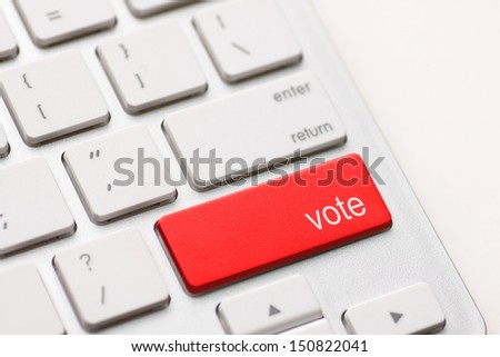 democracy concept with vote button on keyboard - stock photo