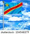 Democratic Republic of Congo waving flag against blue sky - stock photo