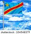 Democratic Republic of Congo waving flag against blue sky - stock photo