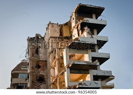 demolished block of flats at sunset - stock photo