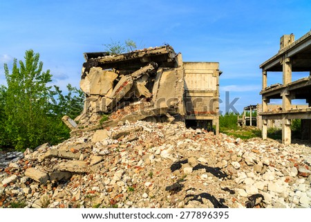 demolished buildings, industrial ruins, earthquake - stock photo