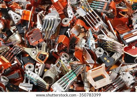 Demolished old hard drive parts as industrial waste background - stock photo