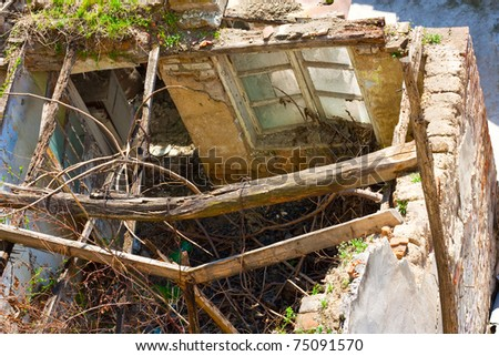 Demolished old house ruins - stock photo