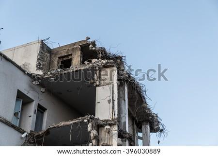 demolishing building - stock photo