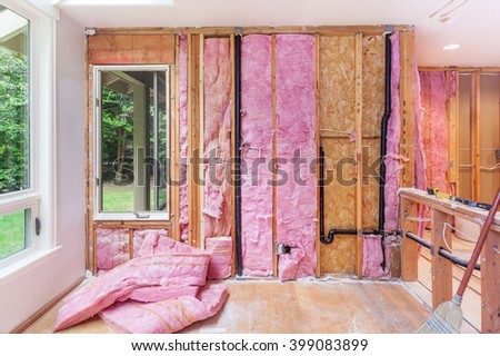 Demolishing the old kitchen - exposing the studs, existing plumbing and electrical work - stock photo