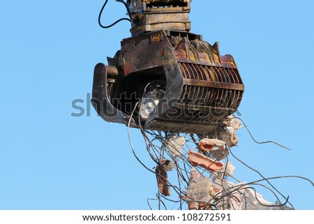 Demolition crane moving rubble - stock photo