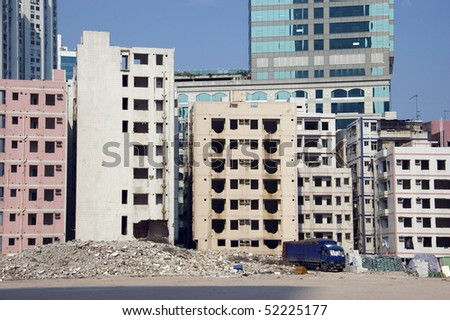 Demolition in China - removing old residential buildings in Shenzhen city. Make space for new hotels, shopping malls and office skyscrapers. - stock photo