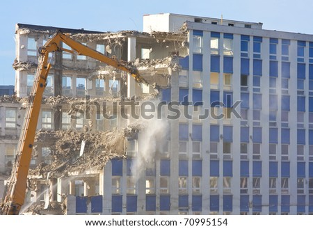 Demolition of a building at construction site - stock photo