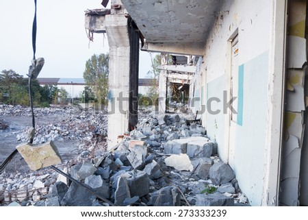 Demolition of a factory building - stock photo