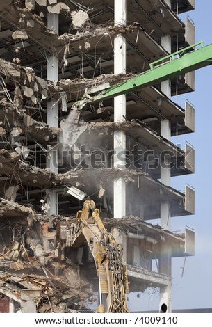 Demolition of a skyscraper - stock photo