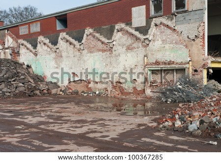 demolition of an old factory building - stock photo