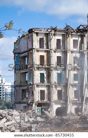 Demolition of building in smoke - stock photo