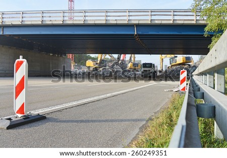demolition of highway bridge - stock photo