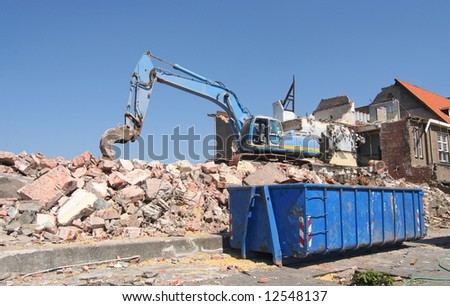 Demolition of old buildings during urban renovation - stock photo