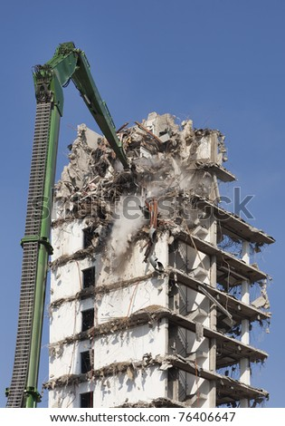 Demolition of s skyscraper - stock photo