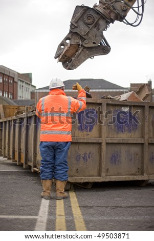 demolition squad destroy an old building to start a new development - stock photo