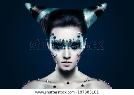 Demon girl with spikes on the face and body - stock photo