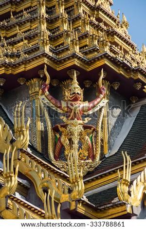 Demon guardian in Wat Phra Kaeo, Bangkok. Wat Phra Kaew is one of the most popular tourists destination in Thailand - stock photo