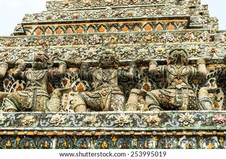 Demon Guardian statues decorating the Buddhist temple Wat Arun in Thailand - stock photo