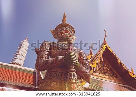 Demon Guardian Wat Phra Kaew Grand Palace, Bangkok,light leak filter. - stock photo