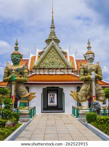 Demon guardians at Wat Arun gate, Bangkok, Thailand - stock photo