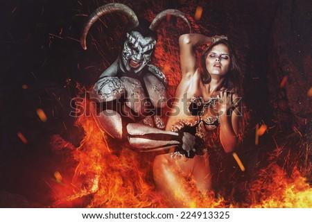 Demon tempting girl on fire - stock photo