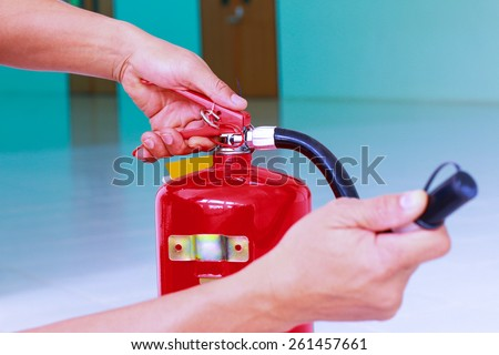 Demonstrate the use of fire fighting equipment. - stock photo