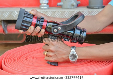 Demonstration. A firefighter Demonstration how yo use nozzle in front fire station.  - stock photo