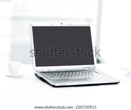 Demonstration of a laptop in the office of the front view. - stock photo