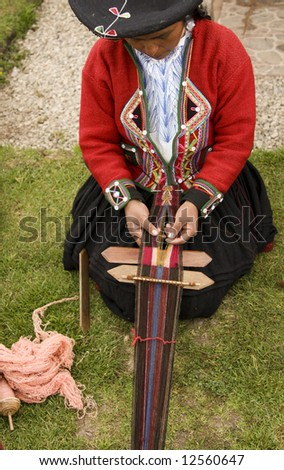 Demonstration of alpaca weaving by the women of Chincheros, Peru, high in the Andes Mountains - stock photo