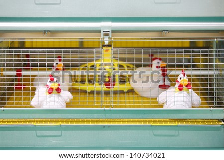 Demonstration of chicken industrial incubator with soft toy chickens. - stock photo