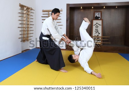 Demonstration of fighting art Aikido. In  sports hall (dodjo) - stock photo