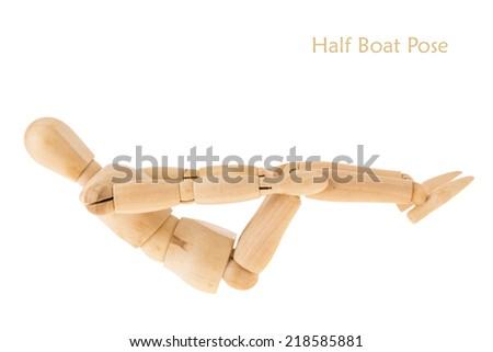 demonstration of wood manikin in half boat pose on white background. this pose is part of yoga training.