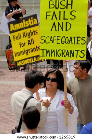 Demonstrator with sign at Los Angeles illegal emigrant rally. May 1st 2006 - stock photo