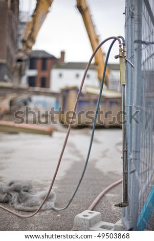 demotion worker using oxy acetylene burner on construction site - stock photo