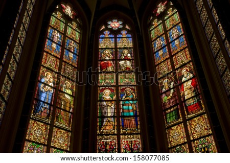 DEN BOSCH, HOLLAND - APRIL 5: Stained glass windows of St. John's Cathedral. The windows date from 1867 and show a.o. Joseph and Mary with child. April 5, 2012. Den Bosch, the Netherlands. - stock photo