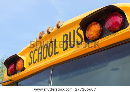 DEN BOSCH, NETHERLANDS - MAY 10, 2015: Close up of an American school bus. In the United States and Canada, every day over 480,000 school buses transport 26 million children to and from schools. - stock photo