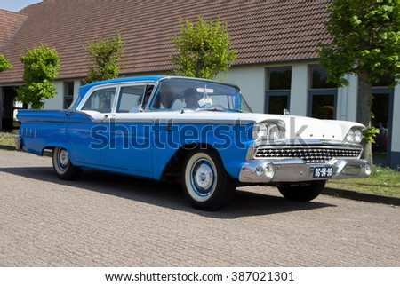 DEN BOSCH, THE NETHERLANDS - MAY 10, 2015: 1960 Ford Custom 300 driving from the parking lot at the Rock Around The Jukebox event.