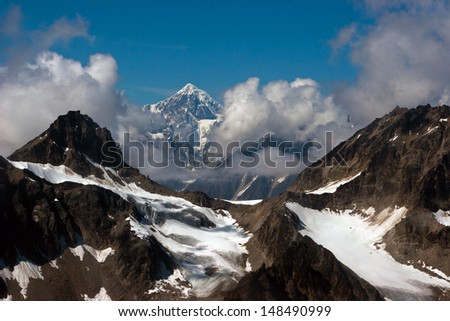 Denali McKinley Mountain Range Ariel Picture on Flight to Glacier Alaska - stock photo