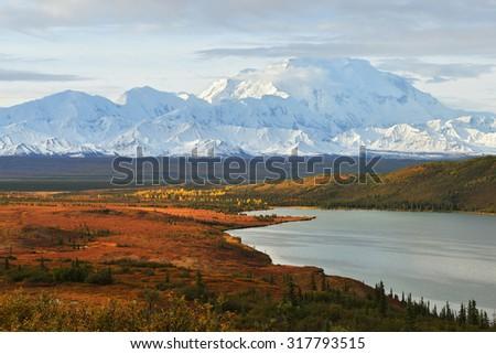 Denali Mountain and Wonder Lake at sunrise, Alaska - stock photo