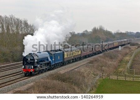 DENCHWORTH, UK - MARCH 21: Peppercorn class Pacific ' Tornado' in its new BR blue livery leads the Cathedrals Express excursion to the West Country on March 21, 2013 in Denchworth
