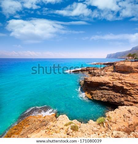 Denia Alicante Las rotas rocky beach in Spain and San Antonio Cape - stock photo