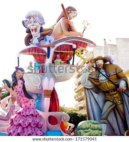 DENIA, ALICANTE, SPAIN - MARCH 18, 2012: Fallas is a popular fest with humor figures on streets that will burn in March  night in Valencia and also Denia in Valencia Province, Spain, March 2012. - stock photo