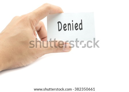 Denied message on the card hand in hand on white background