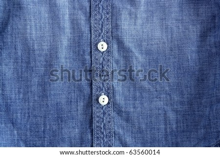 denim blue jeans shirt with buttons detail texture - stock photo