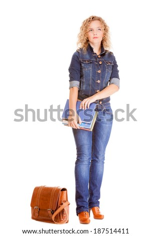 Denim fashion and education. Full length college university student girl with bag books, casual woman in stylish blue jeans pants and jacket high heels. Isolated on white background